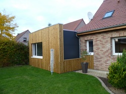 extension ossature bois avec bardage pin autoclave et Trespa