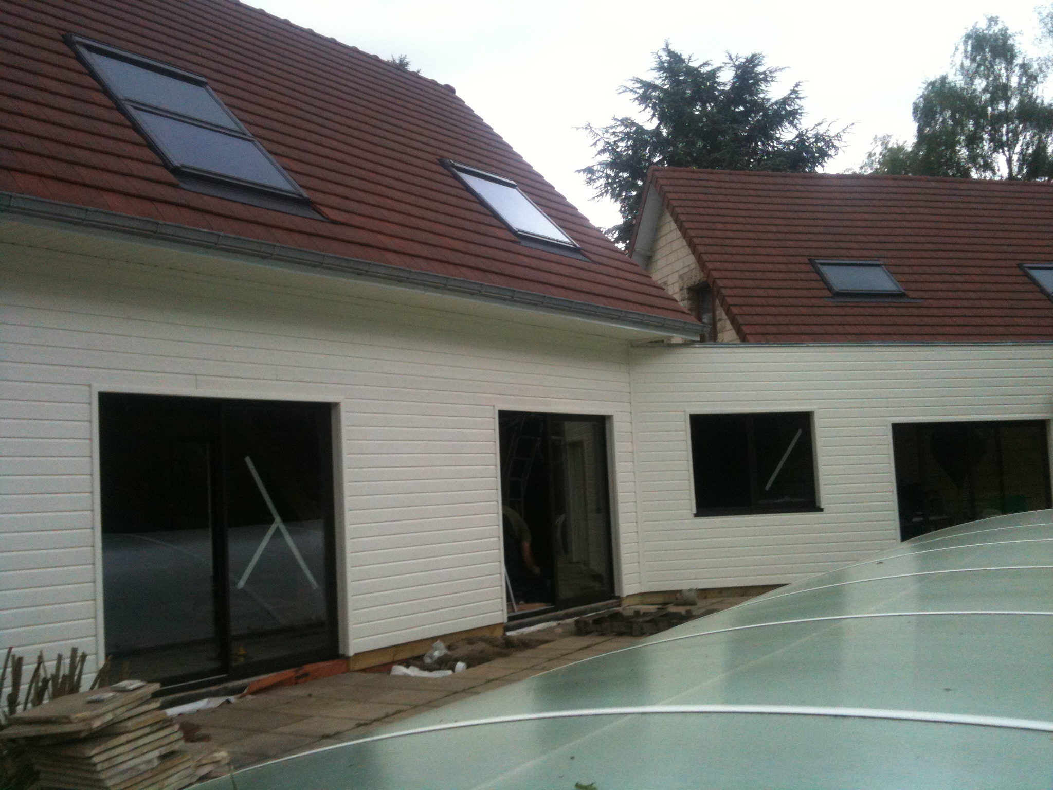 Extension a ossature bois comment agrandir sa maison for Bardage maison composite