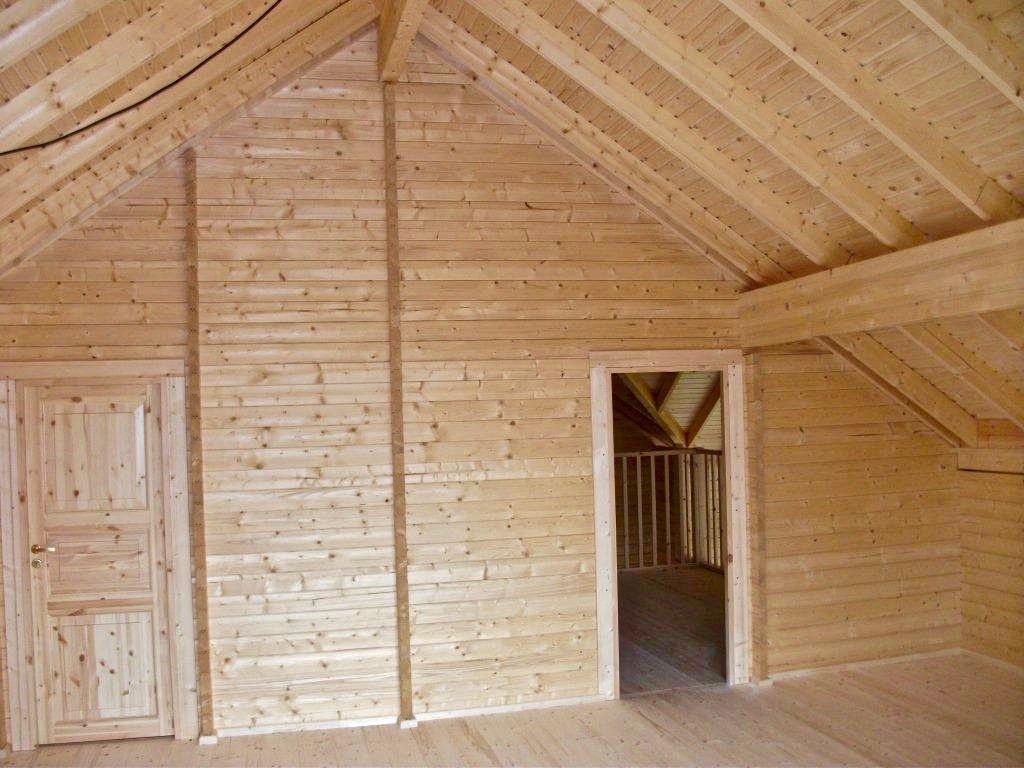 maison en madrier traditionnelle avec porche 5