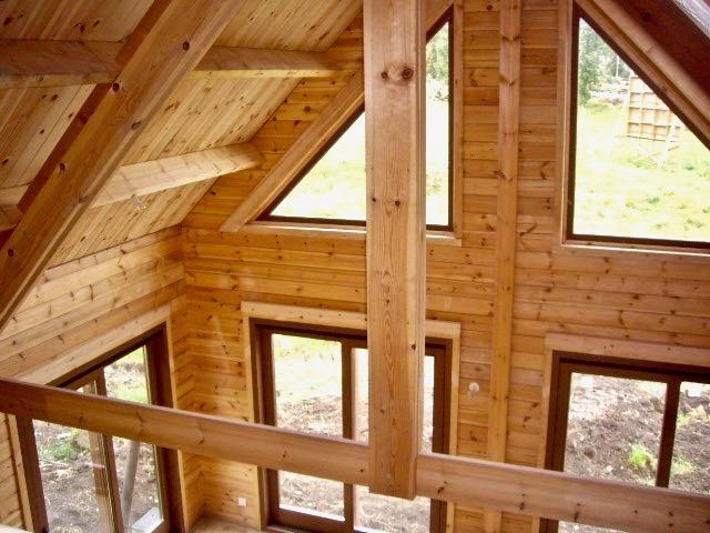maison en madrier traditionnelle avec poutres apparentes 2