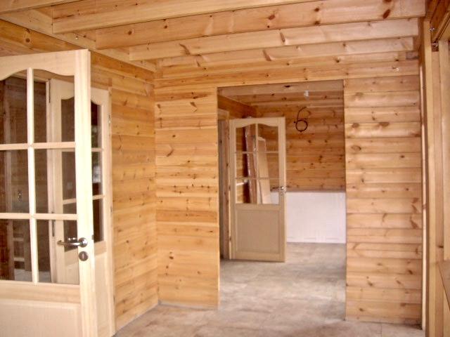 maison en madrier traditionnelle avec poutres apparentes 4